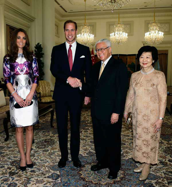 Britain&#39;s Prince William shakes hands with Singapore&#39;s President Tony Tan, second from right, as Tan&#39;s wife Mary Chee, right,  and William&#39;s wife Kate, the Duchess of Cambridge, look on before their meeting at the Istana Presidential Palace in Singapore Tuesday,  Sept. 11, 2012. The British royal couple are on an official three-day trip to Singapore.Middleton wore a patterned shift designed by Singapore-born designer Prabal Gurung for his Spring&#47;Summer 2012 ready-to-wear collection. <span class=meta>(AP Photo&#47; Tim Chong)</span>