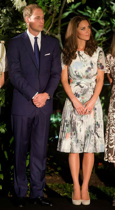Britain&#39;s Prince William and his wife Catherine, the Duchess of Cambridge, listen to speeches at a British Gala reception at the Eden Hall in Singapore on Wednesday September 12, 2012. Britain&#39;s Prince William and his wife Catherine arrived in Singapore on September 11 to kick off a nine-day Southeast Asian and Pacific tour marking Queen Elizabeth II&#39;s Diamond Jubilee.Middleton wore a patterned Erdem Meryl gown, from the designer&#39;s Spring collection. <span class=meta>(AP Photo&#47; NICOLAS ASFOURI)</span>