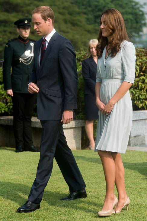 Britain&#39;s Prince William and his wife Kate, the Duke and Duchess of Cambridge, walk together as they pay their respects to the war dead of World War II during a visit to the Kranji Commonwealth War Memorial in Singapore Thursday, Sept. 13, 2012. Middleton wore a Jenny Packham bespoke eucalyptus silk crepe shirt dress with a French lace bodice. <span class=meta>(AP Photo&#47; Nicolas Asfouri)</span>