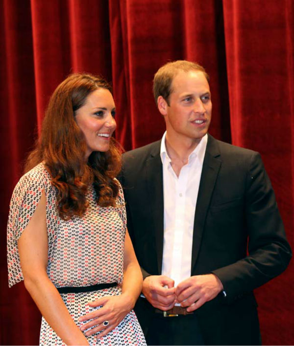 Prince William Duke of Cambridge and his wife Catherine Duchess of Cambridge on stage following a performance at Rainbow Centre, a school for disabled children in Singapore, Wednesday, Sept. 12, 2012. Britain&#39;s Prince William and his wife were greeted by cheering well-wishers as they started an Asia-Pacific tour in Singapore to mark Queen Elizabeth II&#39;s 60-year reign. Middleton wore a cream silk patterned pleated skirt and top, designed by Singapore-based designer Raoul.   <span class=meta>(AP Photo&#47; Stephen Morrison)</span>