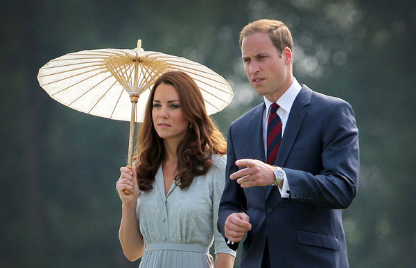 Britain&#39;s Prince William and his wife Kate, the Duke and the Duchess of Cambridge, pay their respect to the war dead of both World War I and World War II at the Kranji Commonwealth War Memorial in Singapore Thursday, Sept. 13, 2012.  Middleton wore a Jenny Packham bespoke eucalyptus silk crepe shirt dress with a French lace bodice. <span class=meta>(AP Photo&#47; Wong Maye-E)</span>