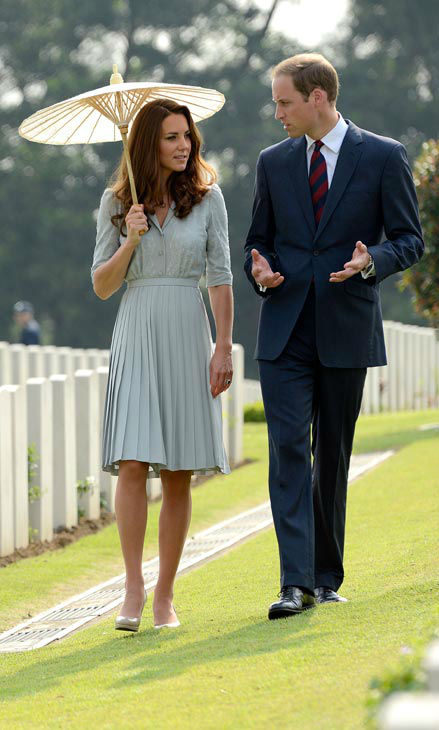 Britain&#39;s Prince William, and his wife Kate, the Duke and the Duchess of Cambridge pay their respects to war dead of both WWI and WWII at the Kranji Commonwealth War Memorial on Thursday Sept. 13, 2012 in Singapore. Middleton wore a Jenny Packham bespoke eucalyptus silk crepe shirt dress with a French lace bodice. <span class=meta>(AP Photo&#47; Bryan van der Beek)</span>