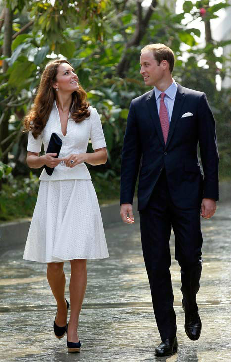 "<div class=""meta image-caption""><div class=""origin-logo origin-image ""><span></span></div><span class=""caption-text"">Prince William, the Duke of Cambridge and Kate, the Duchess of Cambridge tour the Cloud Forest at Singapore's Gardens by the Bay on Wednesday Sept. 12, 2012 in Singapore during their official three day visit. Middleton wore a white eyelet skirt suit designed by Alexander McQueen with navy blue Stuart Weizman Corkswoon wedges. (AP Photo/ Wong Maye-E)</span></div>"