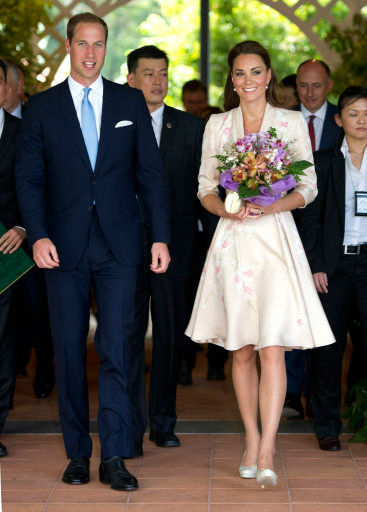 The Duke and Duchess of Cambridge visit the botanic gardens in Singapore on September 12, 2012, on behalf of The Queen in celebration of Her Majesty&#39;s Diamond Jubilee. Middleton wore a Jenny Packham pink knee-length dress with an orchid pattern with off-white L.K. Bennett Sledges. <span class=meta>(Arthur Edwards &#47; The Sun)</span>