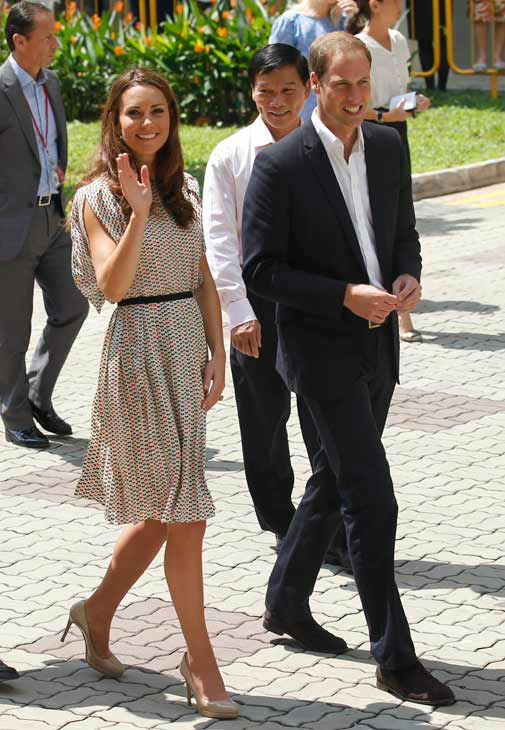 Britain&#39;s Prince William, and his wife Kate, the Duchess of Cambridge visit a local housing estate, Wednesday, Sept. 12, 2012 in Singapore. Middleton wore a cream silk patterned pleated skirt and top, designed by Singapore-based designer Raoul.  <span class=meta>(AP Photo&#47; Wong Maye-E)</span>