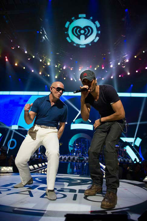 Pitbull and Enrique Iglesias perform onstage during the 2012 iHeartRadio Music Festival at MGM Grand Garden Arena in Las Vegas, Nevada. <span class=meta>(Brian Friedman for Clear Channel.)</span>