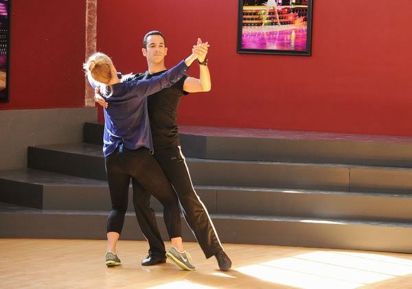 Helio Castroneves and Chelsie Hightower appear in a rehearsal photo for 'Dancing With