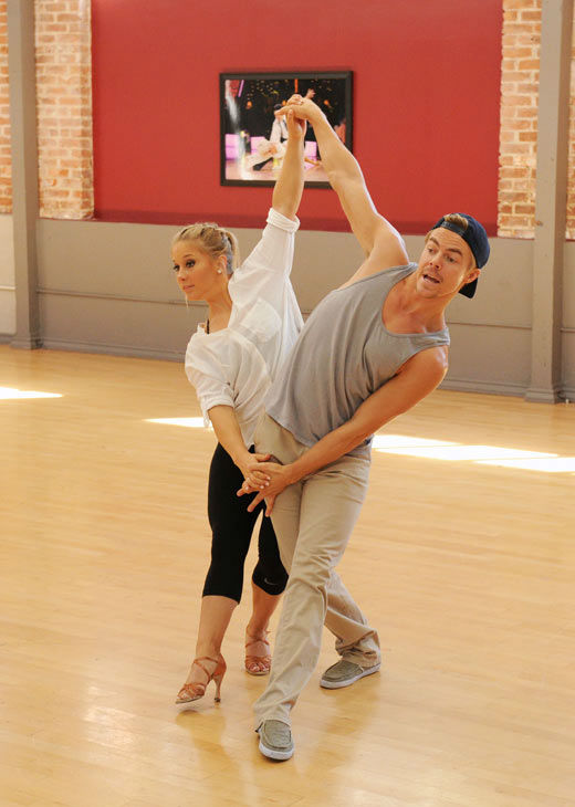 Shawn Johnson and three-time champ Derek Hough appear in a reh