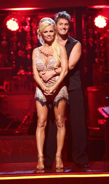 Former Playboy Playmate Pamela Anderson and her partner Tristan MacManus await their fate on 'Dancing With The Stars: The Results Show' on Tuesday, September 25, 2012.