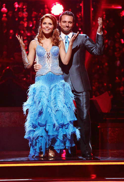"<div class=""meta ""><span class=""caption-text "">Former member of the boy band 98 Degrees, Drew Lachey and his partner Anna Trebunskaya await their fate on 'Dancing With The Stars: The Results Show' on Tuesday, September 25, 2012. The pair received 21.5 out of 30 points from the judges for their Fox Trot on the season premiere of 'Dancing With The Stars: All-Stars,' which aired on September 24, 2012.  (ABC Photo/ Adam Taylor)</span></div>"