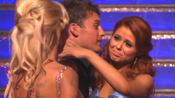"<div class=""meta ""><span class=""caption-text "">Former Playboy Playmate Pamela Anderson and her partner Tristan MacManus react to being eliminated on 'Dancing With The Stars: The Results Show' on Tuesday, September 25. The pair received 17 out of 30 points from the judges for their Cha Cha Cha on the season premiere of 'Dancing With The Stars: All-Stars,' which aired on September 24, 2012.  (ABC Photo)</span></div>"