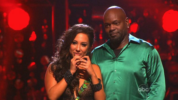 Retired NFL star Emmitt Smith and his partner Cheryl Burke await their fate on 'Dancing With The Stars: The Results Show' on Tuesday, September 25.