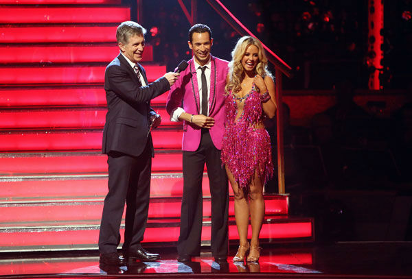 Brazilian auto racing driver Helio Castroneves and his partner Chelsie Hightower await their fate on 'Dancing With The Stars: The Results Show' on Tuesday, Oct. 2, 2012.