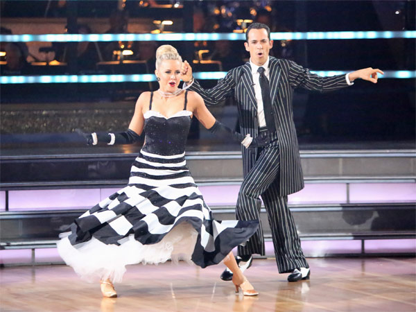 Brazilian auto racing driver Helio Castroneves and his partner Chelsie Hightower received 25.5 out of 30 points from the judges for their Quickstep on 'Dancing With The Stars: All-Stars' on Monday,