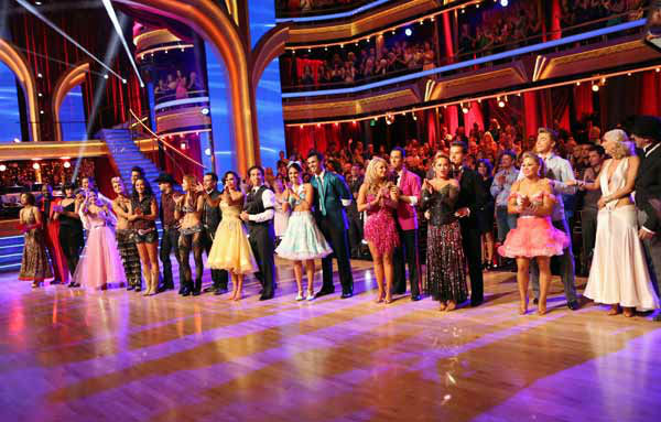 The cast appears in a still from 'Dancing With...