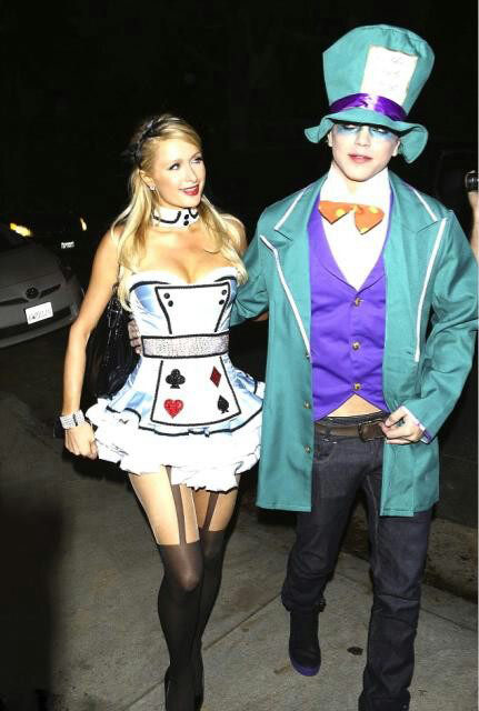 Paris Hilton and male model River Viiperi appears in a photo posted on Hilton's official Twitter page on October 27, 2012. The pair are dressed as Alice and the M