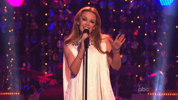 Kylie Minogue sang 'Locomotion' accompanied by pro dancers Kym Johnson and Tristan MacManus on 'Dancing With The Stars: The Results Show' on November 13, 2012.