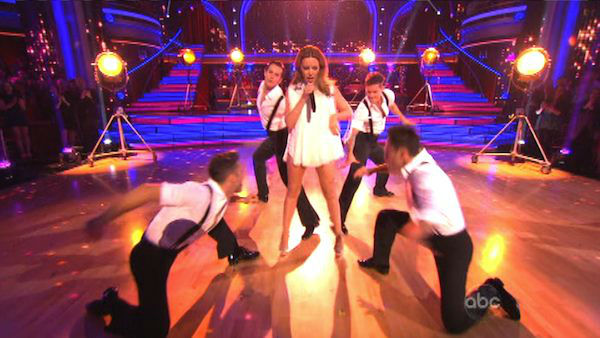 "<div class=""meta image-caption""><div class=""origin-logo origin-image ""><span></span></div><span class=""caption-text"">Kylie Minogue sang 'Locomotion' accompanied by pro dancers Kym Johnson and Tristan MacManus on 'Dancing With The Stars: The Results Show' on November 13, 2012. (ABC Photo)</span></div>"
