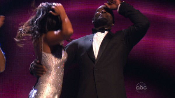 Retired NFL star Emmitt Smith and his partner Cheryl Burke react to being safe from elimination on 'Dancing With The Stars: The Results Show' on November 13, 2012.