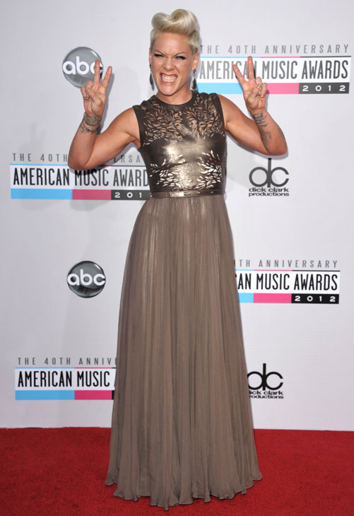 Pink arrives at the 40th Anniversary American Music Awards on Sunday, Nov. 18, 2012, in Los Angeles.
