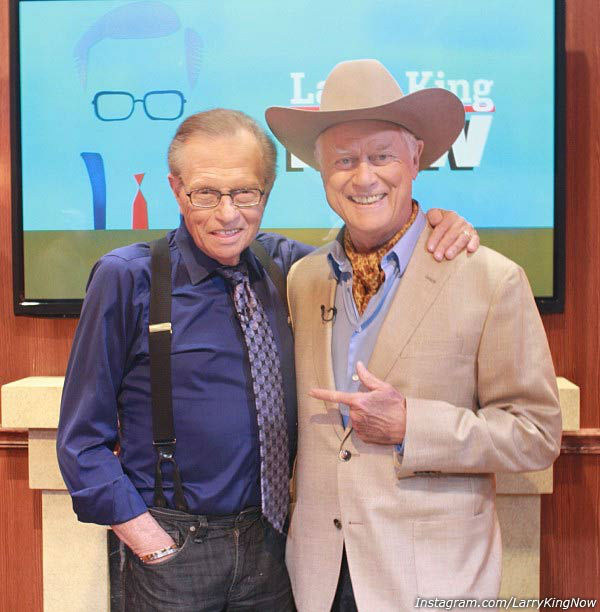 Larry King appears with Larry Hagman in an...