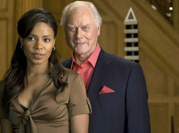 Sanaa Lathan and Larry Hagman appear in an undated promotional photo for 'Nip/Tuck.'