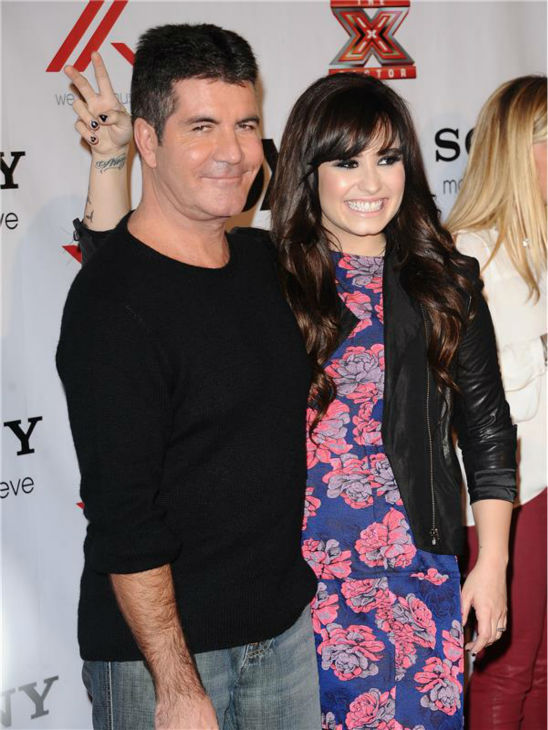 "<div class=""meta ""><span class=""caption-text "">Demi Lovato poses with fellow 'X Factor' judge Simon Cowell at a viewing party for the FOX reality show in Los Angeles on Dec. 6, 2012. (Sara De Boer / startraksphoto.com)</span></div>"