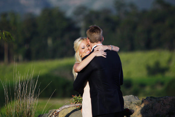 Brad Womack hugs his fiance Emily Maynard on the...