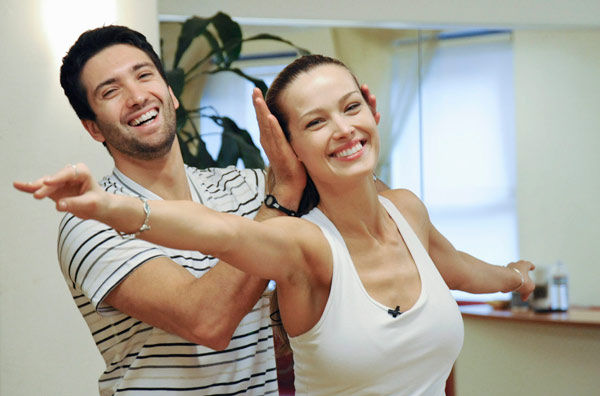 "<div class=""meta ""><span class=""caption-text "">Petra Nemcova, supermodel and founder of the Happy Hearts Fund after surviving the 2004 tsunami in Thaliand, gets ear muffs from partner Dmitry Chaplin during rehearsal for season 12 of 'Dancing with the Stars,' premieres on March 21 at 8 p.m. on ABC. (Photo/Donna Svennevik)</span></div>"