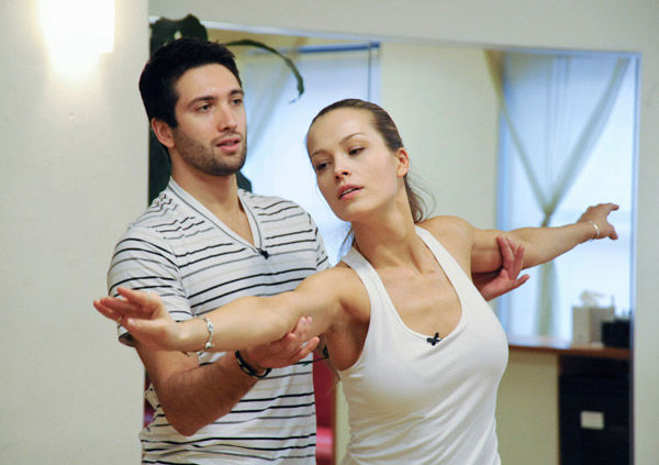 "<div class=""meta ""><span class=""caption-text "">Petra Nemcova, supermodel and founder of the Happy Hearts Fund after surviving the 2004 tsunami in Thaliand, gets an arm lift from partner Dmitry Chaplin during rehearsal for season 12 of 'Dancing with the Stars,' premieres on March 21 at 8 p.m. on ABC. (Photo/Donna Svennevik)</span></div>"