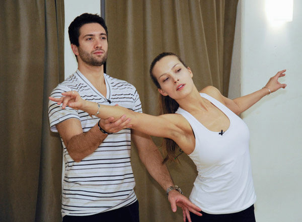 "<div class=""meta ""><span class=""caption-text "">Petra Nemcova, supermodel and founder of the Happy Hearts Fund after surviving the 2004 tsunami in Thaliand, gets a hand from partner Dmitry Chaplin during rehearsal for season 12 of 'Dancing with the Stars,' premieres on March 21 at 8 p.m. on ABC. (Photo/Donna Svennevik)</span></div>"