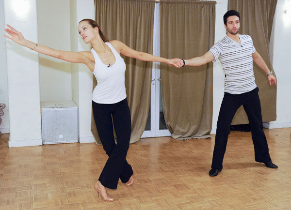 "<div class=""meta ""><span class=""caption-text "">Petra Nemcova, supermodel and founder of the Happy Hearts Fund after surviving the 2004 tsunami in Thaliand, does a ballet pose with partner Dmitry Chaplin during rehearsal for season 12 of 'Dancing with the Stars,' premieres on March 21 at 8 p.m. on ABC. (Photo/Donna Svennevik)</span></div>"