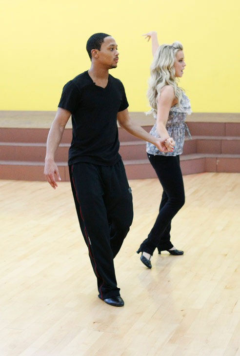 "<div class=""meta image-caption""><div class=""origin-logo origin-image ""><span></span></div><span class=""caption-text"">Romeo, Grammy Award-winning entertainer and CEO of No Limit Forever record company, joins hands with partner Chelsie Hightower during rehearsal for season 12 of 'Dancing with the Stars,' premieres on March 21 at 8 p.m. on ABC. (Photo/Rick Rowell)</span></div>"