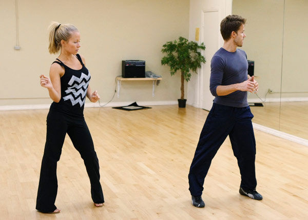 Kendra Wilkinson, reality star of E!&#39;s &#39;Kendra&#39; and formerly &#39;The Girls Next Door,&#39; practices some &#39;Saturday Night Fever&#39; moves with partner Louis Van Amstel during rehearsal for season 12 of &#39;Dancing with the Stars,&#39; premieres on March 21 at 8 p.m. on ABC. <span class=meta>(Photo&#47;Rick Rowell)</span>