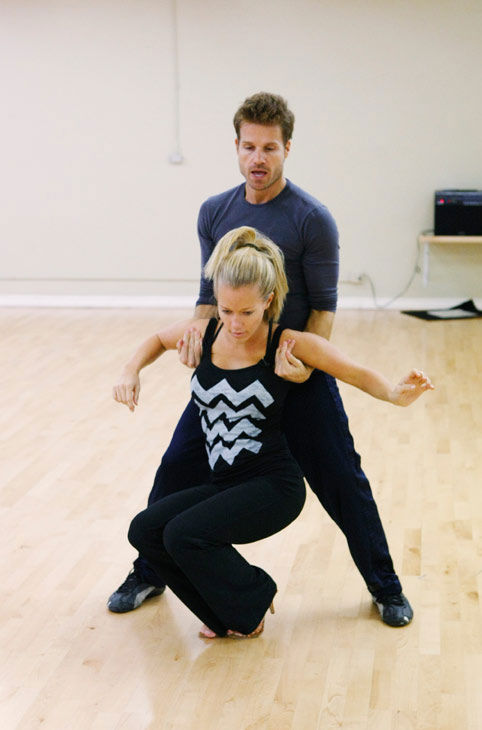 "<div class=""meta ""><span class=""caption-text "">Kendra Wilkinson, reality star of E!'s 'Kendra' and formerly 'The Girls Next Door,' gets held up by partner Louis Van Amstel during rehearsal for season 12 of 'Dancing with the Stars,' premieres on March 21 at 8 p.m. on ABC. (Photo/Rick Rowell)</span></div>"