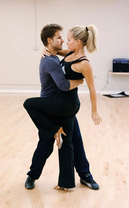 "<div class=""meta ""><span class=""caption-text "">Kendra Wilkinson, reality star of E!'s 'Kendra' and formerly 'The Girls Next Door,' strikes a sexy pose with partner Louis Van Amstel during rehearsal for season 12 of 'Dancing with the Stars,' premieres on March 21 at 8 p.m. on ABC. (Photo/Rick Rowell)</span></div>"
