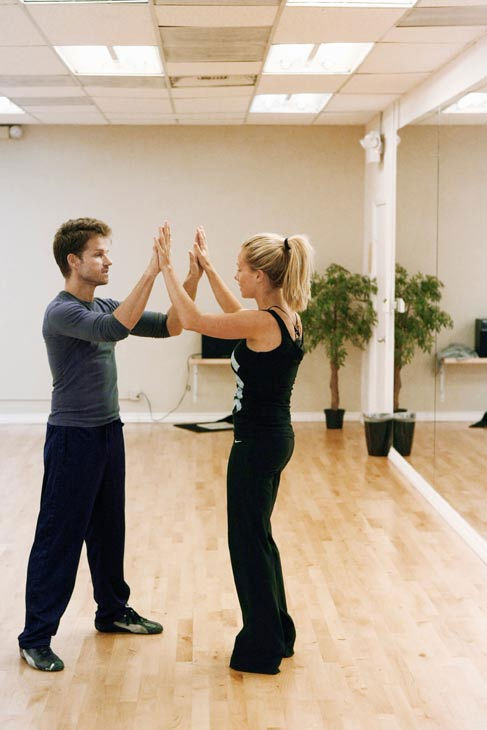 Kendra Wilkinson, reality star of E!&#39;s &#39;Kendra&#39; and formerly &#39;The Girls Next Door,&#39; plays patty cake with partner Louis Van Amstel during rehearsal for season 12 of &#39;Dancing with the Stars,&#39; premieres on March 21 at 8 p.m. on ABC. <span class=meta>(Photo&#47;Rick Rowell)</span>