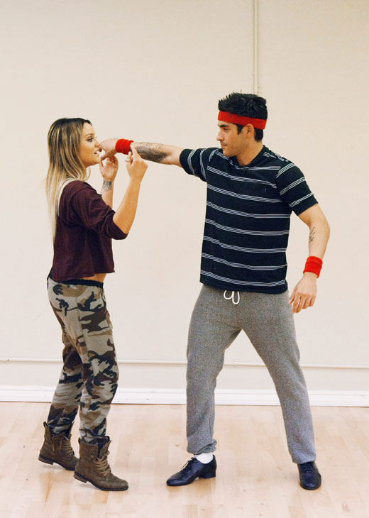 'Psycho' Mike Catherwood, KROQ-FM and Loveline Radio co-cost, offers a knuckle sandwich to his partner Lacey Schwimmer during rehearsal for season 12 of 'Dancing with the Stars,' premieres on March 21 at 8 p.m. on ABC.