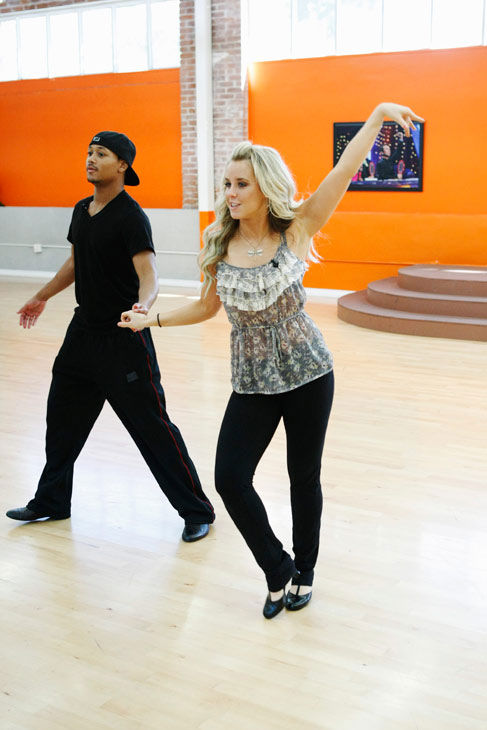 "<div class=""meta ""><span class=""caption-text "">Romeo, Grammy Award-winning entertainer and CEO of No Limit Forever record company, gets a hand from his partner Chelsie Hightower during rehearsal for season 12 of 'Dancing with the Stars,' premieres on March 21 at 8 p.m. on ABC. (Photo/Rick Rowell)</span></div>"