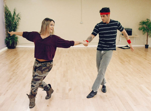 'Psycho' Mike Catherwood, KROQ-FM and Loveline Radio co-cost, learns some fancy foot work with partner Lacey Schwimmer during rehearsal for season 12 of 'Dancing with the Stars,' premieres on March 21 at 8 p.m. on ABC.
