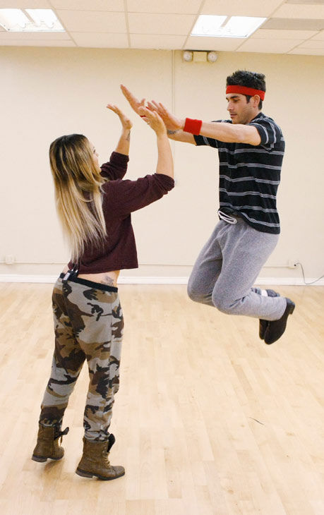 "<div class=""meta ""><span class=""caption-text "">'Psycho' Mike Catherwood, KROQ-FM and Loveline Radio co-cost, shows off his jumping skills with partner Lacey Schwimmer during rehearsal for season 12 of 'Dancing with the Stars,' premieres on March 21 at 8 p.m. on ABC. (Photo/Rick Rowell)</span></div>"
