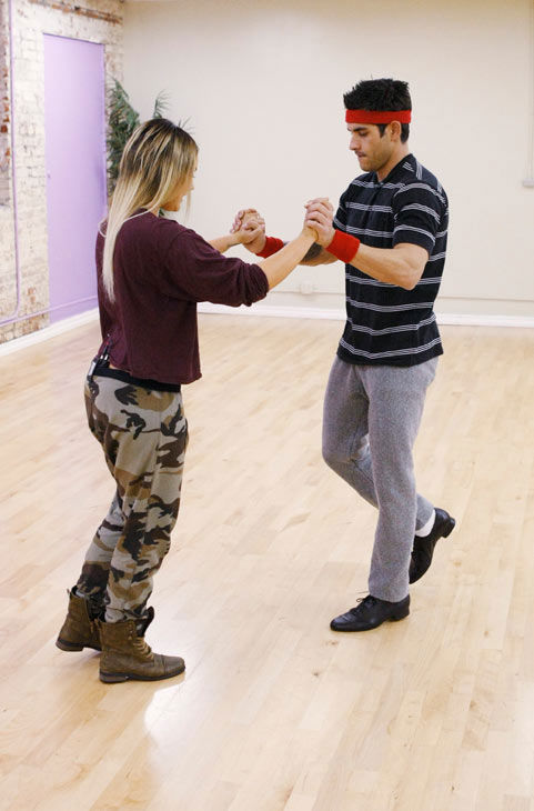 &#39;Psycho&#39; Mike Catherwood, KROQ-FM and Loveline Radio co-cost, makes a bridge with partner Lacey Schwimmer during rehearsal for season 12 of &#39;Dancing with the Stars,&#39; premieres on March 21 at 8 p.m. on ABC. <span class=meta>(Photo&#47;Rick Rowell)</span>