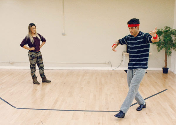 'Psycho' Mike Catherwood, KROQ-FM and Loveline Radio co-cost, practices his waltzing stance with partner Lacey Schwimmer during rehearsal for season 12 of 'Dancing with the Stars,' premieres on March 21 at 8 p.m. on ABC.