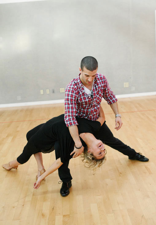 "<div class=""meta ""><span class=""caption-text "">Chelsea Kane, star of 'The Homes' web series and voice of Bea in Disney's 'Fish Hooks,' gets an extreme dip from her partner Mark Ballas during rehearsal for season 12 of 'Dancing with the Stars,' premieres on March 21 at 8 p.m. on ABC. (Photo/Rick Rowell)</span></div>"