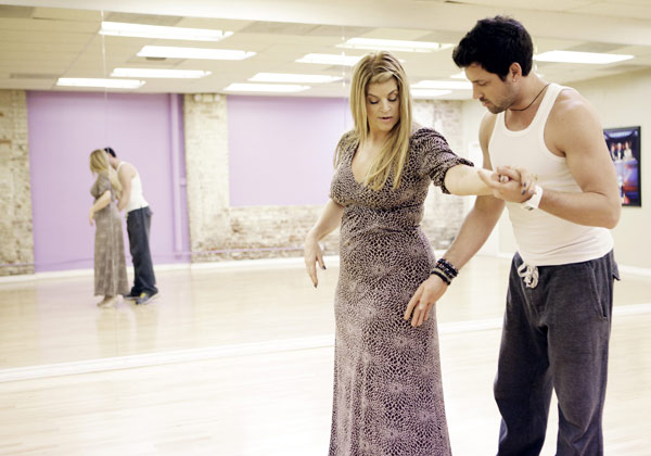 Kirstie Alley, Emmy and Golden Globe-winning actress, takes the lead from her partner Maksim Chmerkovskiy during rehearsal for season 12 of '