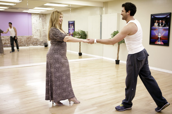 Kirstie Alley, Emmy and Golden Globe-winning actress, gets a hand from her partner Maksim Chmerkovskiy during rehearsal for season 12 of 'Dancing with the Stars,' premieres on March 21 at 8 p.m. on ABC.