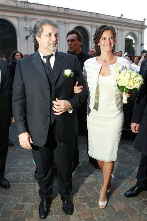 Andrea Bocelli&#39;s bride, longtime partner Veronica Berti appears at their wedding with an unidentified man at the Sanctuary of Montenero in Italy on March 21, 2014. This marks the second marriage for the famed Italian tenor. He and Berti are parents to a daughter, who celebrated her second birthday on their wedding day, and he also has two sons from a previous marriage. <span class=meta>(Masjordan Image &#47; Abaca &#47; Startraksphoto.com)</span>
