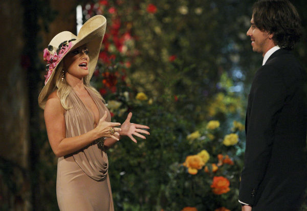 "<div class=""meta ""><span class=""caption-text "">Holly and Ben Flajnik appear in a scene from the premiere of the 16th season of ABC's 'The Bachelor,' which airs on Jan. 2, 2012. (ABC Photo/ Rick Rowell)</span></div>"