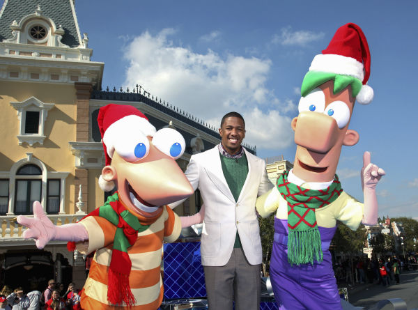 Nick Cannon is joined by Disney Channel characters Phineas and Ferb during the taping of the 2011 Disney Parks Christmas Day Parade at Disneyland in Anaheim, California, on Nov. 5, 2011. The show airs Christmas Day, at various times across the country, on ABC.  <span class=meta>(Disneyland &#47; Paul Hiffmeyer)</span>