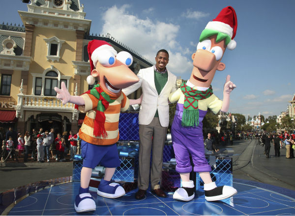 "<div class=""meta image-caption""><div class=""origin-logo origin-image ""><span></span></div><span class=""caption-text"">Nick Cannon is joined by Disney Channel characters Phineas and Ferb during the taping of the 2011 Disney Parks Christmas Day Parade at Disneyland in Anaheim, California, on Nov. 5, 2011. The show airs Christmas Day, at various times across the country, on ABC.  (Disneyland / Paul Hiffmeyer)</span></div>"